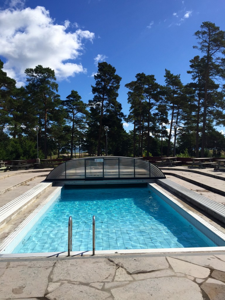 This camping next to the beach has a pool. With a roof that is. We are in Sweden.
